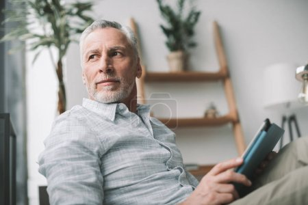 Photo for Senior businessman working with tablet computer in office - Royalty Free Image