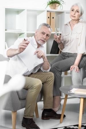 Senior colleagues converse at office