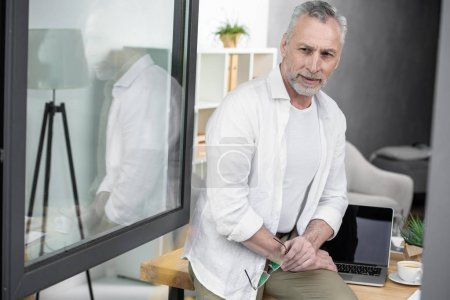 businessman near window at office