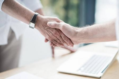 Photo for Business partners shaking hands at office - Royalty Free Image