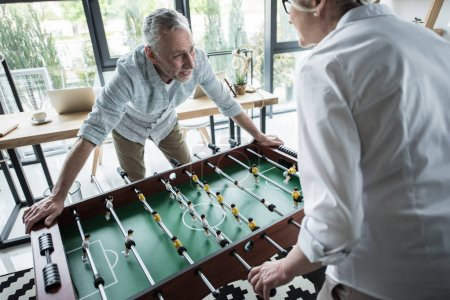 colleagues playing foosball