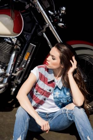 Young woman with motorbike