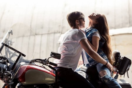 Young couple with motorcycle