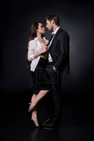 sexy woman seducing man in suit