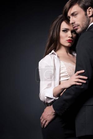 sensual couple embracing ang looking away
