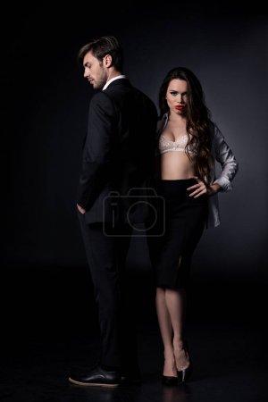 sexy woman standing with boyfriend