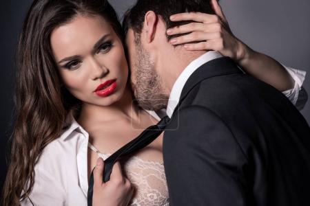 passionate couple kissing in erotic scene