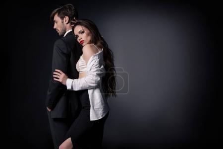Photo pour Fille sexy hugging bel homme en vêtements - image libre de droit