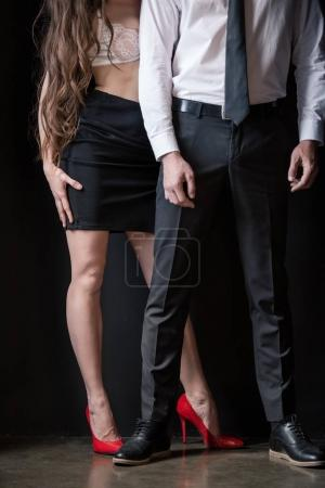 Sexy woman with man in formal wear