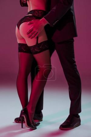 man touching buttocks of sexy woman