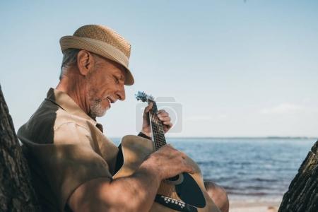 Senior man with guitar
