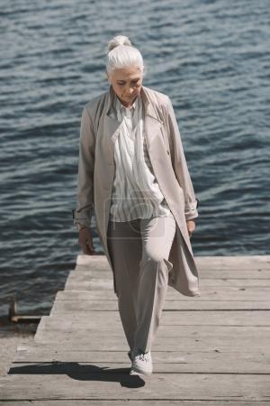 Senior woman at riverside