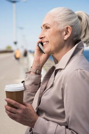 Senior woman talking on smartphone