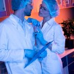 Постер, плакат: Scientists having office romance
