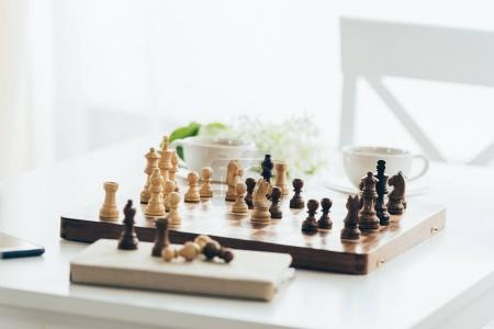 Wooden chessboard with pieces