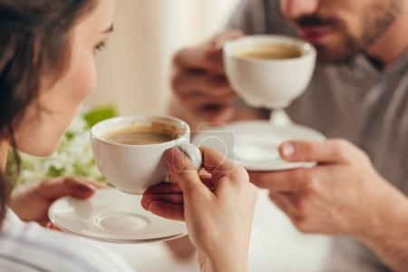 young couple drinking coffee at home
