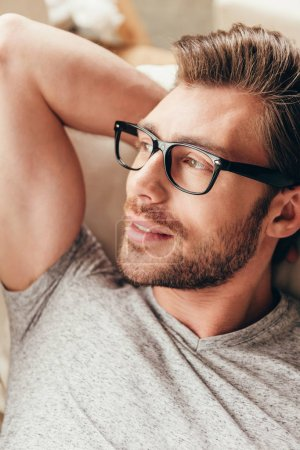Photo for Close up portrait of young handsome man in glasses looking away - Royalty Free Image