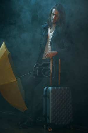 Young man with suitcase