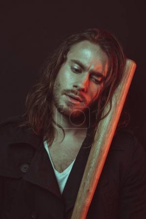 Young man with baseball bat