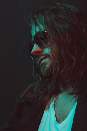 long haired caucasian man in sunglasses