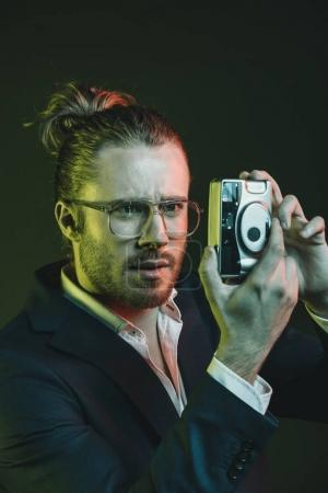 stylish man taking photo on camera