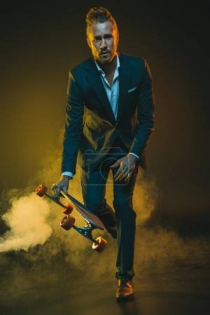 man in suit riding on skateboard