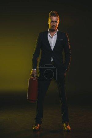 man in tuxedo holding fire extinguisher