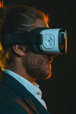 Photo for Profile of young man using virtual reality headset - Royalty Free Image