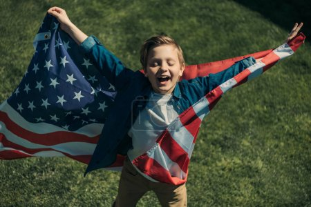 little boy with american flag