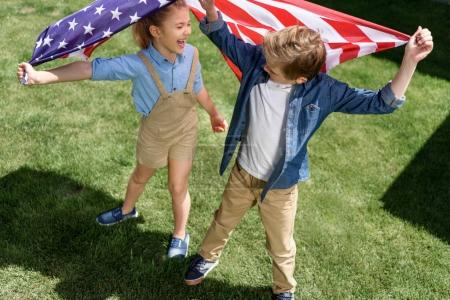 siblings with american flag