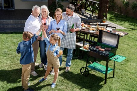 family having barbecue together