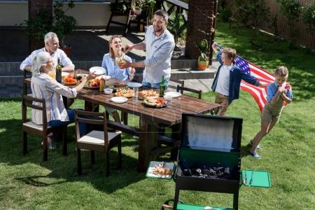 family celebrating 4th july