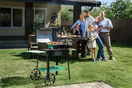 family spend time together at barbecue