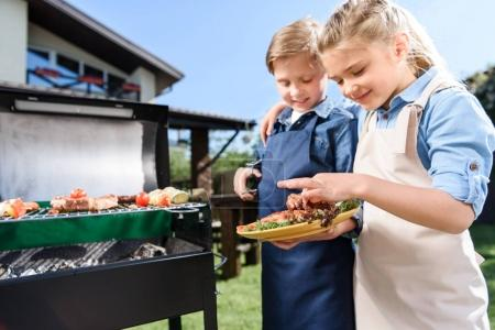 Children testing cooked meat