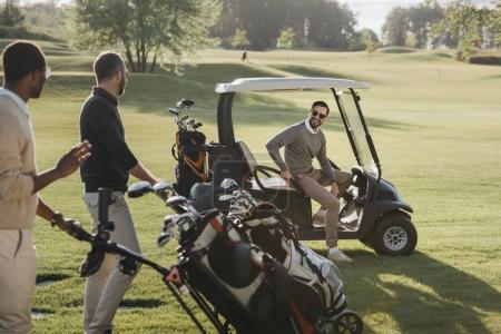 Multiethnic golf players