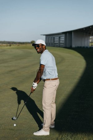 African american man playing golf