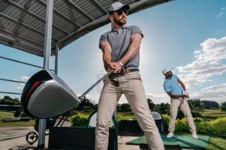 Men playing golf
