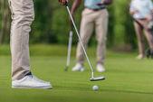 golfer getting ready to shot on fairway