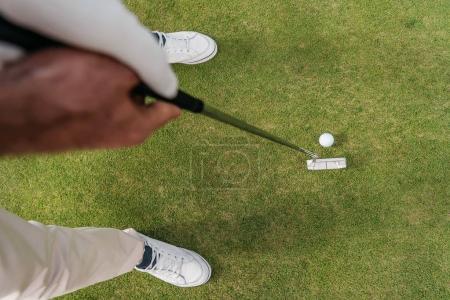 Sportsman holding golf club