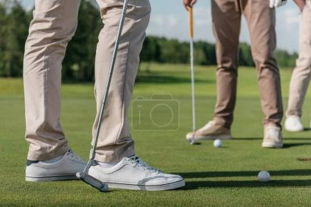 Golf players getting ready to shot