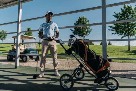 golf player with golf club