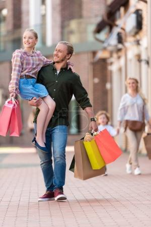 Father and daughter shopping