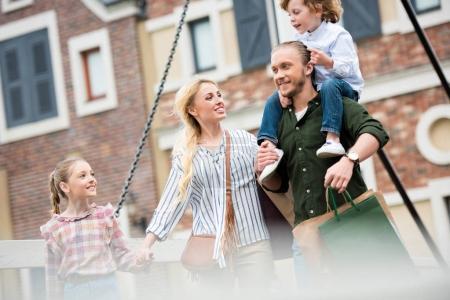family walking on street