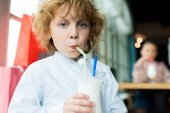boy drinking milkshake