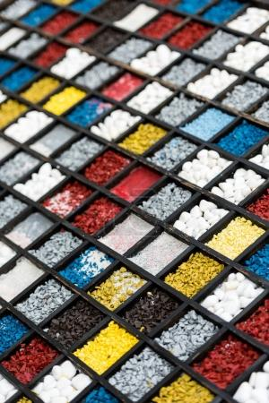 colorful stones in wooden slots