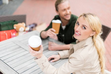 Couple drinking coffee at cafe