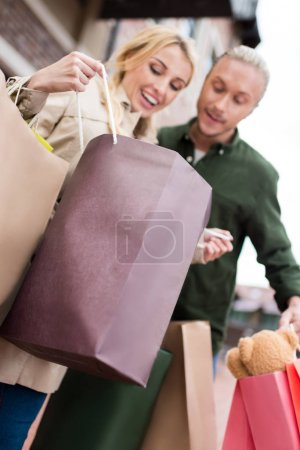 Happy couple looking into shopping bags
