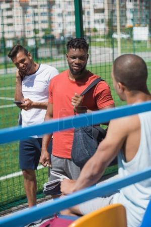Multicultural men on stadium