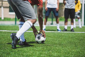 soccer players at pitch