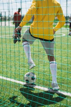 goalkeeper with ball at pitch